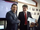 Vladimir Naborov is handed the certificate